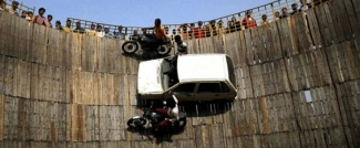 powerful motordrome well of death show with 5 bikes and 4 cars