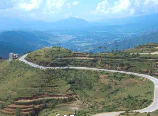 http://www.blogoftheworld.com/wp-content/uploads/2013/09/Nepal_landscape_terraced_farming_road1.jpg
